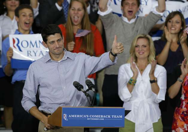 Vice presidential running mate Rep. Paul Ryan, R-Wis, gives the thumbs at his  a welcome home rally Sunday, Aug. 12, 2012 in Waukesha, Wis. (AP Photo/Jeffrey Phelps) (JEFFREY PHELPS / Associated Press)