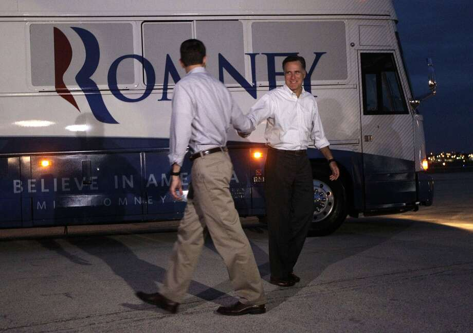 Republican presidential candidate, former Massachusetts Gov. Mitt Romney, and vice presidential running mate Rep. Paul Ryan, R-Wis., shake hands as they part ways at the airport, Sunday, Aug. 12, 2012 in Milwaukee. (AP Photo/Mary Altaffer) (Mary Altaffer / Associated Press)