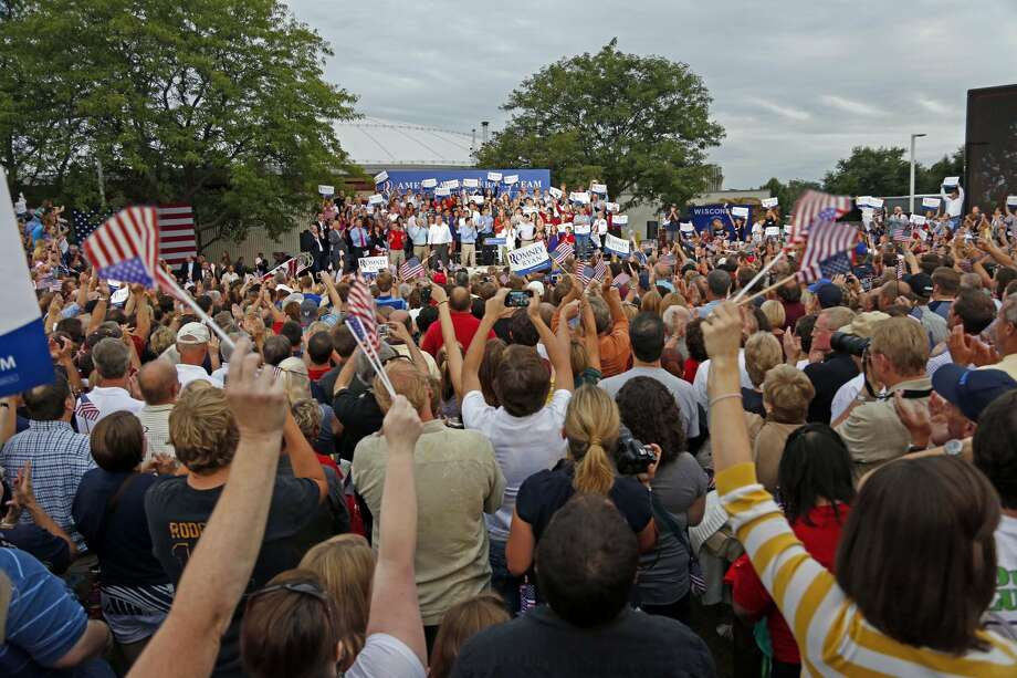 Thousands of supporters listen to Republican presidential candidate Mitt Romney and his running mate, Rep. Paul Ryan, R-Wis, at a welcome home rally Sunday, Aug. 12, 2012 in Waukesha, Wis. (AP Photo/Jeffrey Phelps) (JEFFREY PHELPS / Associated Press)