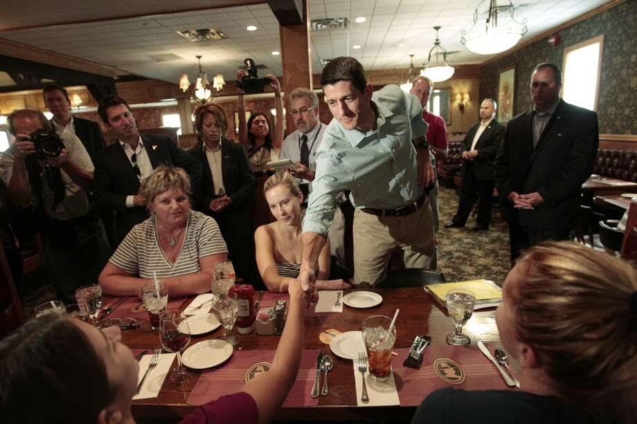 Republican vice presidential candidate, Rep. Paul Ryan, R-Wis., speaks to diners at Puritan Backroom restaurant, Saturday, Aug. 25, 2012 in Manchester, N.H.  (AP Photo/Mary Altaffer) (Mary Altaffer / Associated Press)