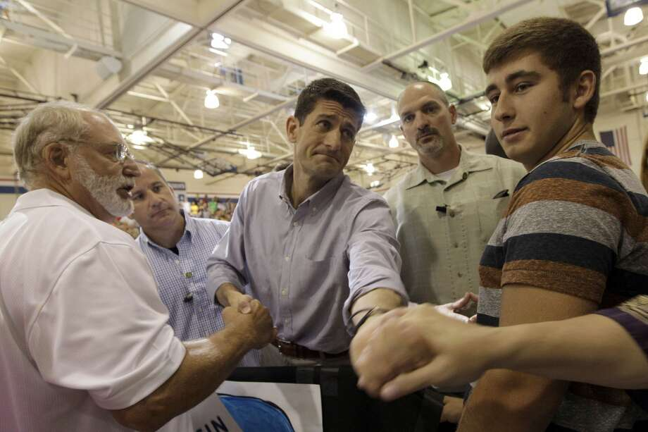 Republican vice presidential candidate, Rep. Paul Ryan, R-Wis., greets supporters during a campaign event at Joseph A. Craig High School, Monday, Aug. 27, 2012, in  Janesville, Wis.  (AP Photo/Mary Altaffer) (Mary Altaffer / Associated Press)