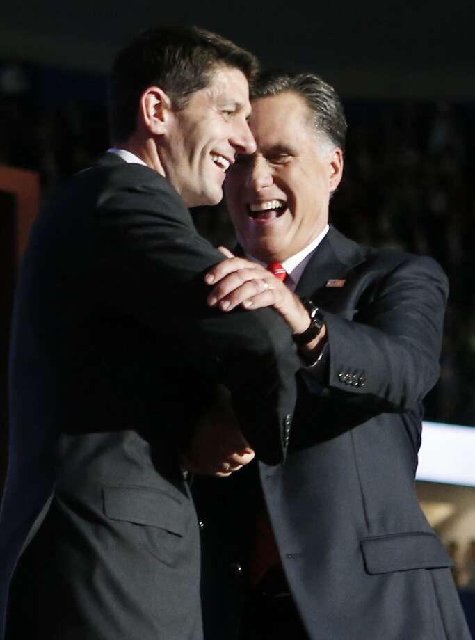 Republican presidential nominee Mitt Romney shakes hands with Republican vice presidential nominee, Rep. Paul Ryan after speaking at the Republican National Convention in Tampa, Fla., on Thursday, Aug. 30, 2012.(AP Photo/Jae C. Hong) (Associated Press)