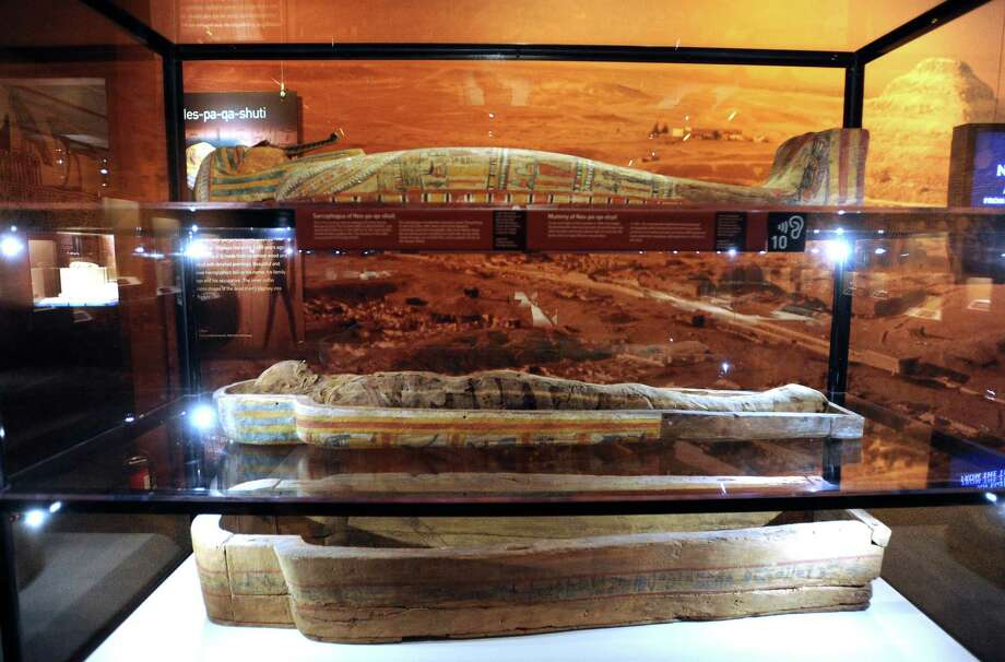 """The sarcophagus and mummy of a man named Nes-pa-qa-shuti, which dates to about 650 B.C., is on display at the """"Mummies of the World"""" touring exhibit at the Witte Museum on Tuesday, Sept. 25, 2012. Photo: Billy Calzada, San Antonio Express-News / © San Antonio Express-News"""