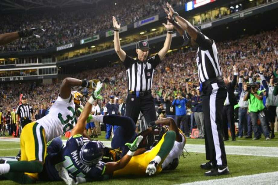 """Replacing the replacementsFans and pundits predicted a blown call would decide a critical game when the NFL started the season with replacement officials. Sure enough, in Week 3, on the national stage of """"Monday Night Football,"""" a missed offensive pass interference penalty and a questionable touchdown catch handed the Seattle Seahawks a win over the Green Bay Packers. Two days later, the league resolved its labor dispute with the regular refs."""