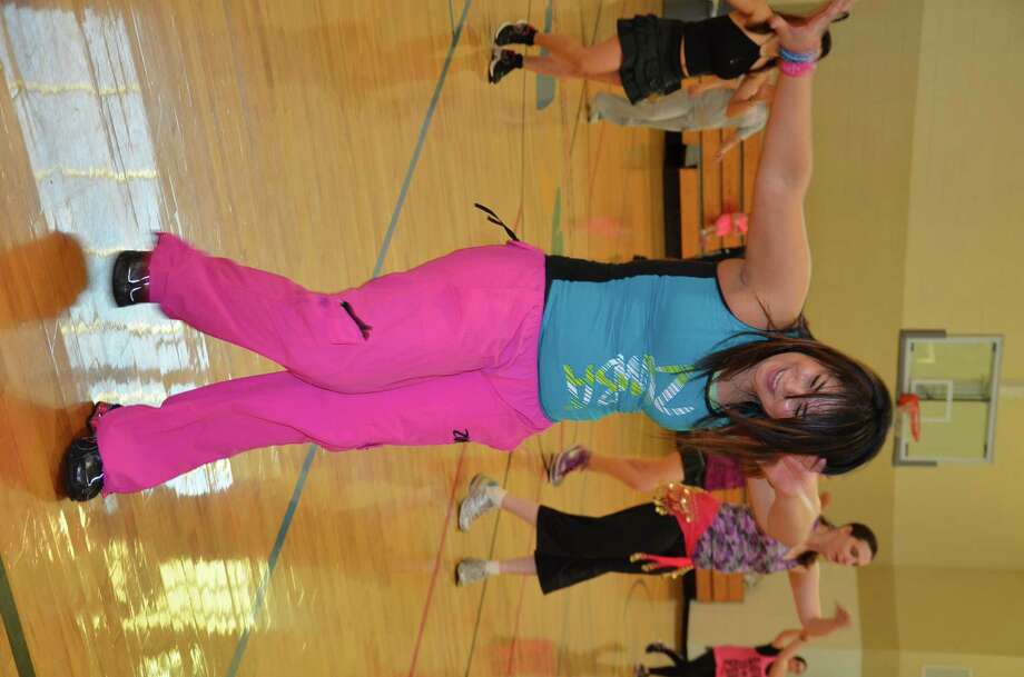 Several people at the Branch Crossing YMCA participate in a Zumba excercise.