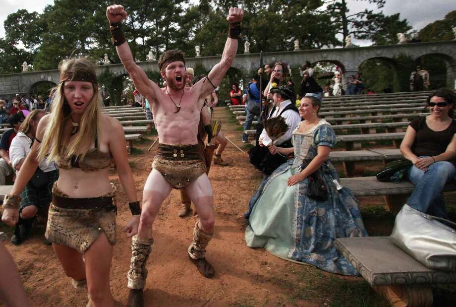 (center)  Brian Barrow growls during the Best Dressed Barbarian Contest at the Renaissance Festival on Sunday, Nov. 20, 2011, in Plantersville. Photo: Mayra Beltran, Houston Chronicle / © 2011 Houston Chronicle