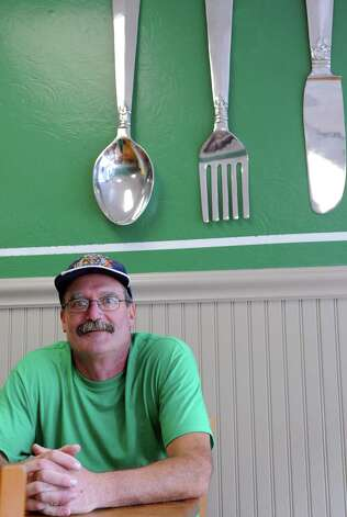 Eric Screnock, owner of That Awesome Deli & Gluten Free Food Factory on Belltown Road, poses for a photo inside the store on Wednesday, September 26, 2012. The store features completely seperate utensils, storage and food preparation areas for gluten-free and non-gluten free items. Photo: Lindsay Niegelberg / Stamford Advocate