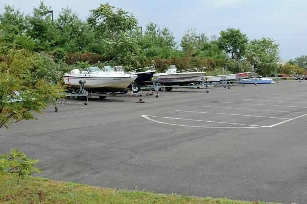 Boats sit on property at 205 Magee Avenue in Stamford on Wednesday, September 26, 2012. Photo: Lindsay Niegelberg / Stamford Advocate