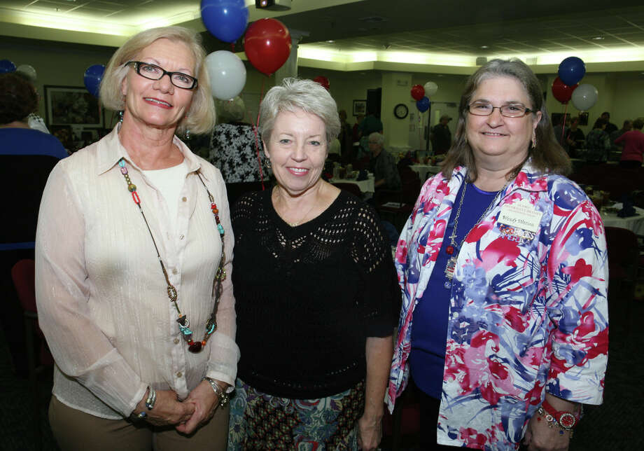 Alamo Decorative Artists tribute to wounded warriors: Committee  members Susan Herr (from left), Kathy Swigon and Wendy Watson turn out  for the tribute at Independence Hill Assisted Living.