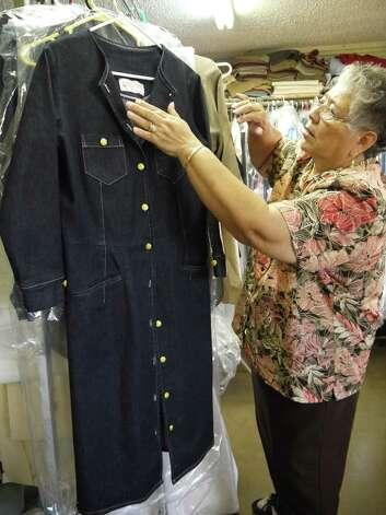 Petra Mata, Fuerza Unida co-founder inspects an organic denim long coat that will be featured in the group's upcoming fashion show. Photo: Michael Quintanilla, Staff