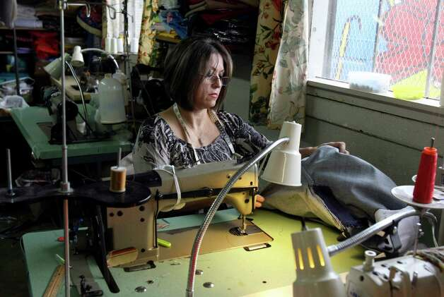 Belen Lira sews a pair of jeans at Fuerza Unida. The organization, made up of women who were let go from Levi Strauss factories on the South Side, will host a fashion show in which they'll launch their own line of denim clothing. The benefit will help fund a new building. Photo: Helen L. Montoya, Staff / ©SAN ANTONIO EXPRESS-NEWS