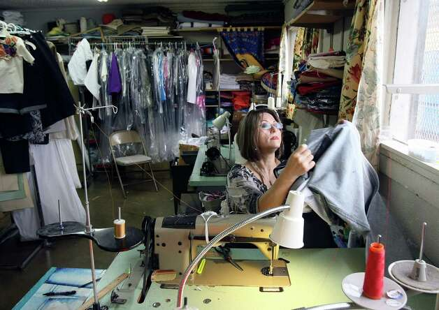 Belen Lira sews a pair of jeans on Friday Sept. 14, 2012. Fuerza Unida, an organization made up of women who in the early 1990s were let go without notice or severance pay from Levi Strauss factories on the South Side, will host a fashion show on Sept. 29 in which they'll launch their own line of denim clothing. The benefit, Trenzando Comunidades, will help fund a new building. Photo: Helen L. Montoya, Staff / ©SAN ANTONIO EXPRESS-NEWS