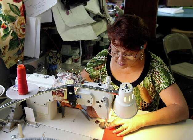 Letty Garza is one of two seamstresses at Fuerza Unida.  The organization is made up of women who in the early 1990s were let go without notice or severance pay from Levi Strauss factories on the South Side and will host a fashion show on Sept. 29 in which they'll launch their own line of denim clothing. The benefit, Trenzando Comunidades, will help fund a new building. Photo: Helen L. Montoya, Staff / ©SAN ANTONIO EXPRESS-NEWS