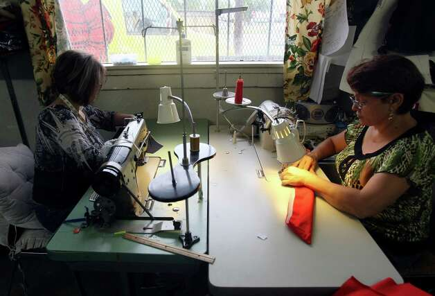 Belen Lira and Letty Garza are the only seamstresses at Fuerza Unida  The organization, made up of women who in the early 1990s were let go without notice or severance pay from Levi Strauss factories on the South Side, will host a fashion show on Sept. 29 in which they'll launch their own line of denim clothing. The benefit, Trenzando Comunidades, will help fund a new building. Photo: Helen L. Montoya, Staff / ©SAN ANTONIO EXPRESS-NEWS