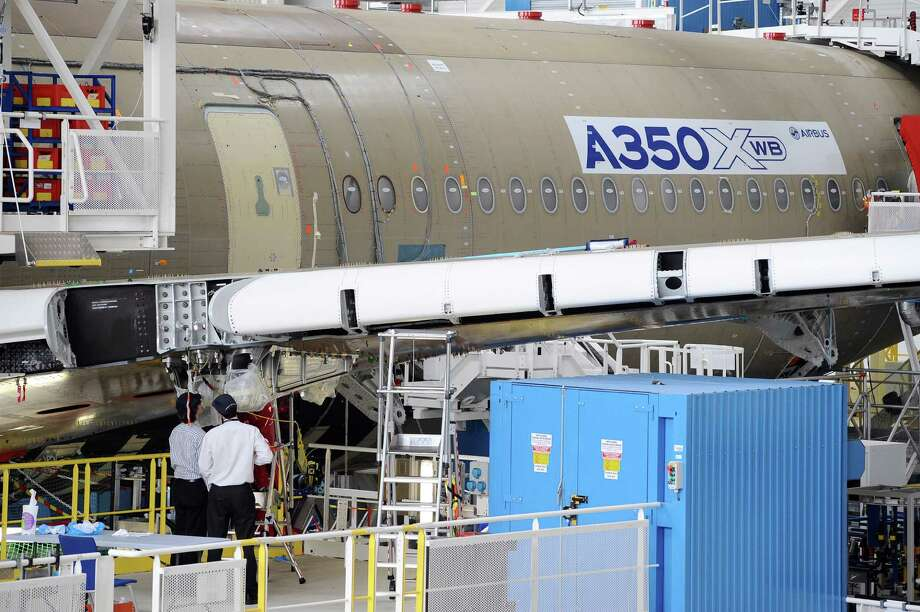 Technicians work in Airbus' A350 XWB assembly plant. Photo: AFP, AFP/Getty Images / 2012 AFP