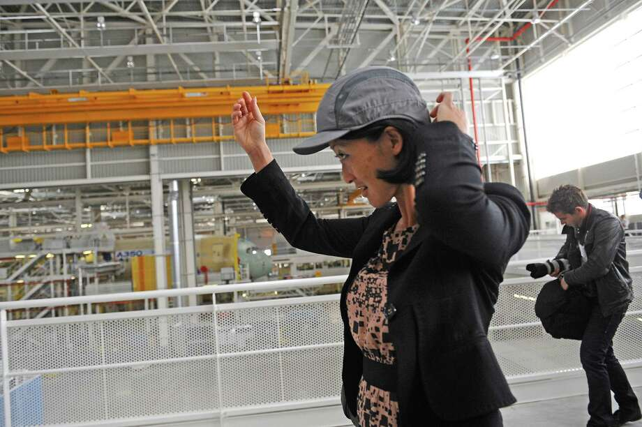 French Junior Minister for Small and Medium Enterprises, Innovations and Digital Economy Fleur Pellerin visits the Airbus A350 XWB assembly plant in Toulouse, France, on Sept. 24, 2012. Photo: AFP, AFP/Getty Images / 2012 AFP