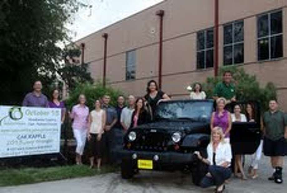From left are tournament committee members with the 2013 Jeep Wrangler.
