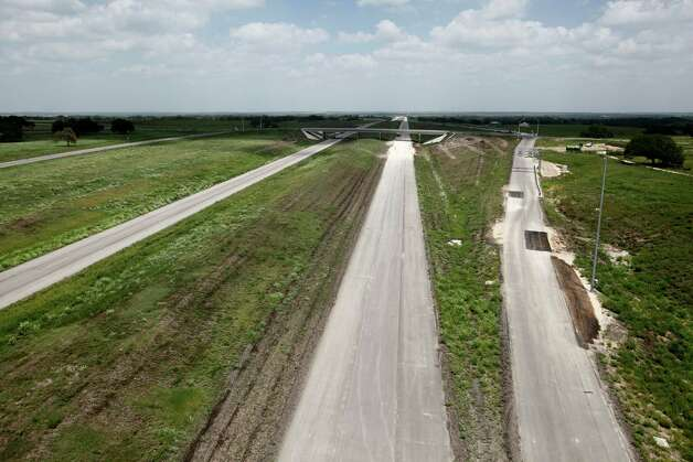The still-under-construction State Highway 130 between Lockhart and Seguin, Texas is seen in this Thursday afternoon July 26, 2012 aerial photo. Also called Toll 130, it runs from Seguin, parallel to I-35, all the way to Georgetown and will be the closest toll road to San Antonio. Photo: William Luther, San Antonio Express-News / © 2012 San Antonio Express-News