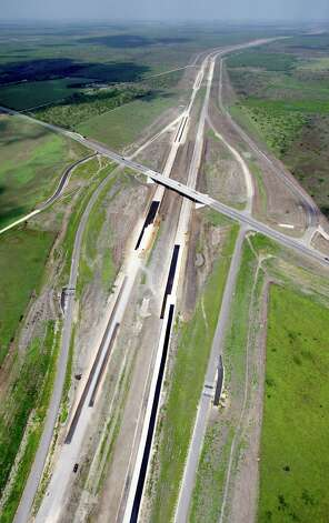 The still-under-construction State Highway 130 between Lockhart and Seguin, Texas goes as far as the eye can see in this Thursday afternoon July 26, 2012 aerial photo. Also called Toll 130, it runs from Seguin, parallel to I-35, all the way to Georgetown and will be the closest toll road to San Antonio. Photo: William Luther, San Antonio Express-News / © 2012 San Antonio Express-News