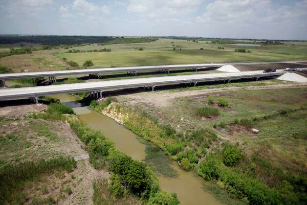 The still-under-construction State Highway 130 between Lockhart and Seguin, Texas passes over a creek in this Thursday afternoon July 26, 2012 aerial photos. Also called Toll 130, it runs from Seguin, parallel to I-35, all the way to Georgetown and will be the closest toll road to San Antonio. Photo: William Luther, San Antonio Express-News / © 2012 San Antonio Express-News