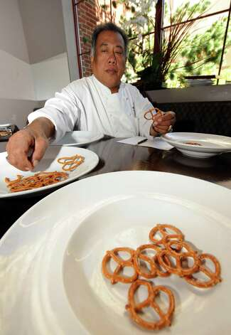 Chef Yono Purnomo taste test pretzels in Albany , NY Thursday Sept. 20, 2012. (Michael P. Farrell/Times Union) Photo: Michael P. Farrell
