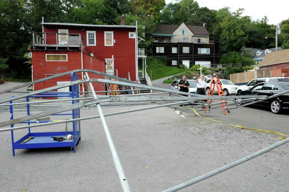 A metal frame collapsed Wednesday afternoon in the area of 143 River Road, directly adjacent to Sandy's Summer Stand. Two people were transported to Stamford Hospital with injuries. Photo: Helen Neafsey / Greenwich Time