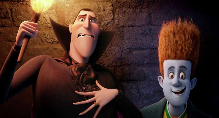 "This film image released by Sony pictures shows Dracula, voiced by Adam Sandler, left, and Johnnystein, voiced by Andy Samberg in a scene from ""Hotel Transylvania."" (AP Photo/Sony Pictures) Photo: AP, HOEP / Sony Pictures"