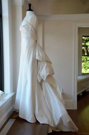 This bridal gown, designed by Anna Maier, catches the afternoon light in the window of Darien's new bridal boutique, A Little Something White.  September 25, 2012, Darien, Conn. Photo: Jeanna Petersen Shepard