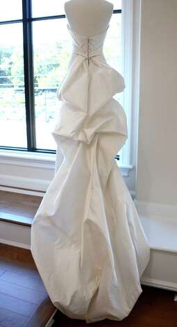 This bridal gown designed by Anna Maier stands on display in the new bridal boutique, A Little Something White, in Darien, Connecticut.  September 25, 2012. Photo: Jeanna Petersen Shepard