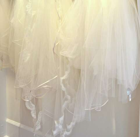 A Little Something White Bridal Couture carries an exquisite selection of bridal gowns and veils, in Darien, Connecticut.  September 25, 2012. Photo: Jeanna Petersen Shepard