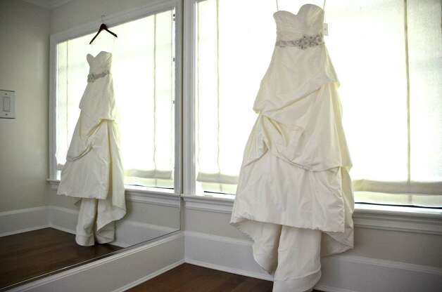 This Judd Waddell dress hangs in a fitting room in the newly opened bridal boutique, A Little Something White, in Darien, Connecticut.  September 25, 2012. Photo: Jeanna Petersen Shepard
