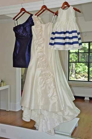 A Little Something White Bridal Couture carries an array of designs by Darien resident Coren Moore, as seen hanging here in the fiiting room.  September 25, 2012, Darien, Conn. Photo: Jeanna Petersen Shepard