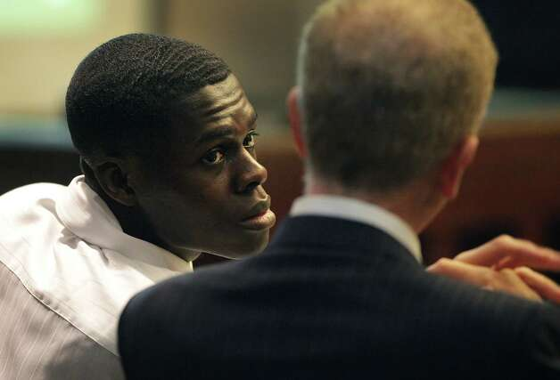 Kwaku Agyin, left, confers with his attorney Mario Trevino during his child sex trafficking trial in Judge Lori Valenzuela's 437th state District Court.   Wednesday, Sept. 26, 2012. Photo: BOB OWEN, San Antonio Express-News / © 2012 San Antonio Express-News