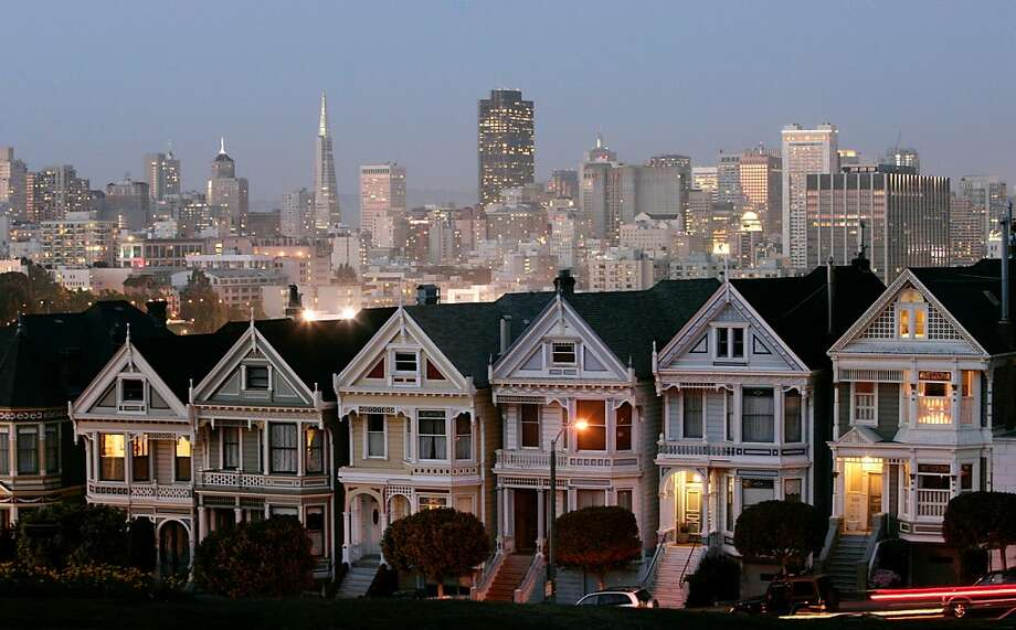 A row of historical Victorian homes, underscore the San Francisco skyline in a view from Alamo Square. Photo: Marcio Jose Sanchez, Associated Press