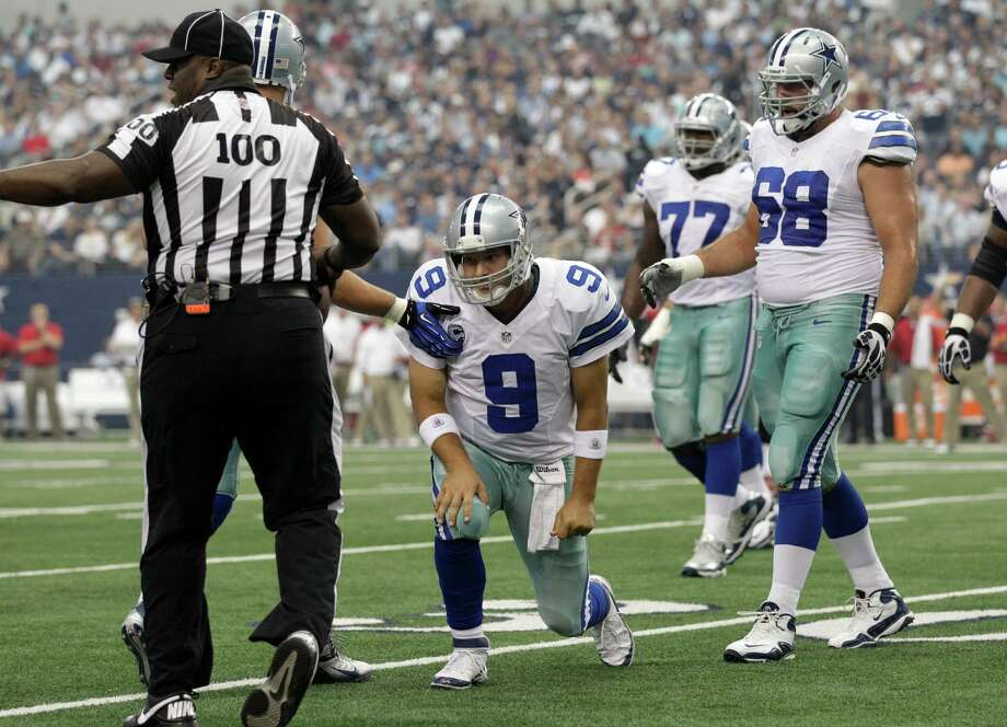 Cowboys right tackle Doug Free (68) comes to quarterback Tony Romo's aid in last weekend's 16-10 victory over Tampa Bay at Cowboys Stadium. Photo: Tony Gutierrez, Associated Press / AP