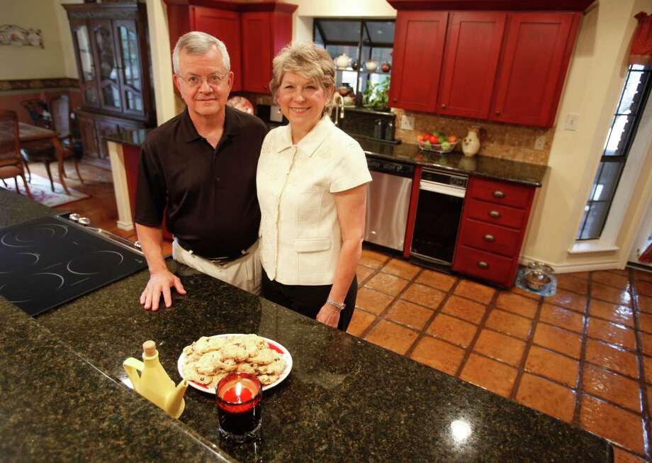 Susan and Mark Smith pose Tuesday Sept. 25, 2012 in their kitchen. Mark Smith, a retired minister who started Fellowship Bible Church, built the Smith's home 28 years ago and rebuilt the kitchen two years ago. Photo: William Luther, San Antonio Express-News / © 2012 San Antonio Express-News