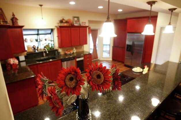 Susan and Mark Smith's kitchen is seen Tuesday Sept. 25, 2012. Mark Smith, a retired minister who started Fellowship Bible Church, built the Smith's home 28 years ago and rebuilt the kitchen two years ago. Photo: William Luther, San Antonio Express-News / © 2012 San Antonio Express-News