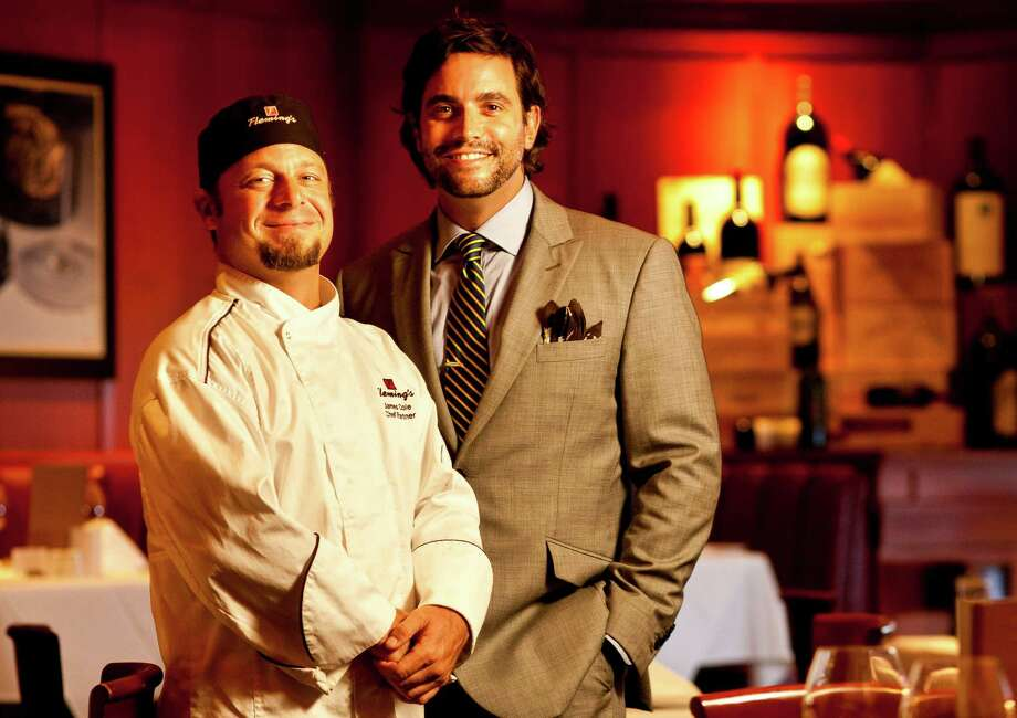 Fleming's Prime Steakhouse & Wine Bar's James Cole, left, and Sam Governale say they believe in connecting with what's important to customers. Photo: Nick De La Torre / © 2012 Houston Chronicle