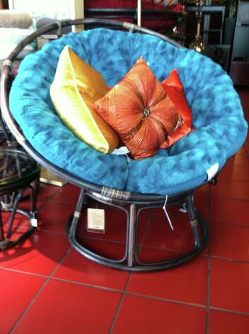 Papasan chair frame, $49.95; faux fur teal cushion, $90; beaded pillow, $39.95; orange and yellow velvet pillows, $29.95 each; Pier 1 Imports, www.pier1.com. Photo: Melanie Warner