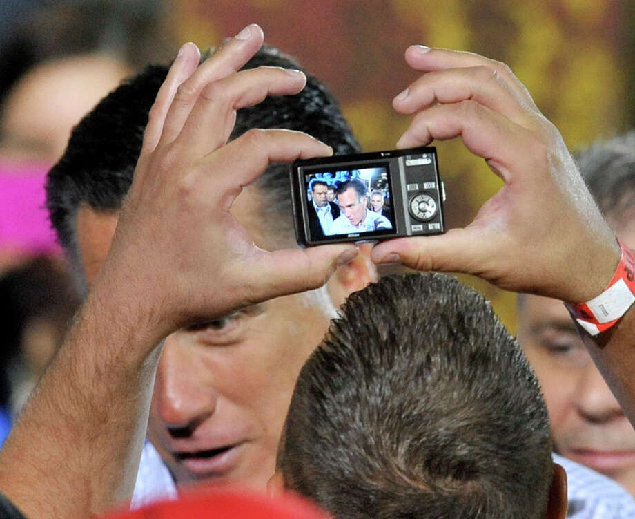 A supporter photographs Republican presidential candidate, former Massachusetts Gov. Mitt Romney during a campaign stop at American Spring Wire, Wednesday, Sept. 26, 2012, in Bedford Heights, Ohio.  (AP Photo/ David Richard) Photo: David Richard, Associated Press / FR25496 AP