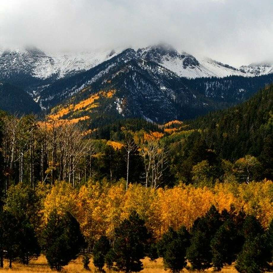 "Flagstaff, AZ: Sunshine, great dining, and golden leaves: ""Flag""  is Arizona's capital of autumn. In fall, the air in Flagstaff is crisp as a Winesap, the skies are the dictionary definition of blue, and the return of 18,000 NAU students gives ""Flag"" a Red Bull swigging, outdoorsy zing. Explore the historic downtown or head to the hills for some seasonal hiking. Also, don't miss Coconino National Forest, located north of town, for the state's most spectacular aspens set against the backdrop of dormant volcano Humphreys Peak. Read more: Top 5 fall hikes Photo: Logan Brumm, Sunset.com"
