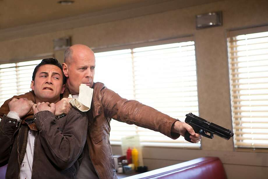 "Joseph Gordon-Levitt and Bruce Willis as ""Joe"" in TriStar Pictures, Film District, and End Game Entertainment's action thriller LOOPER. Photo: Alan Markfield, Sony Pictures"