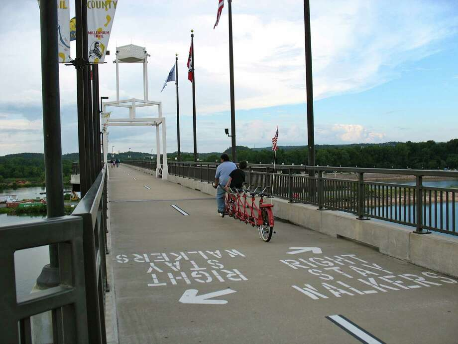 The views are spectacular from the Big Dam Bridge, a long pedestrian and bicyclist bridge built above a dam on the Arkansas River in Little Rock, Ark. Photo: Betty Luman / © 2012  Houston Chronicle