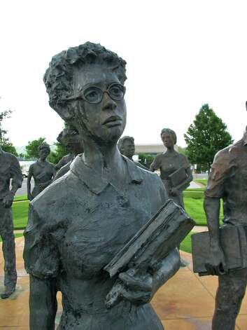 """Testimony,"" a bronze sculpture of the Little Rock Nine, on the grounds of the Arkansas State Capitol. Photo: Betty Luman / © 2012  Houston Chronicle"