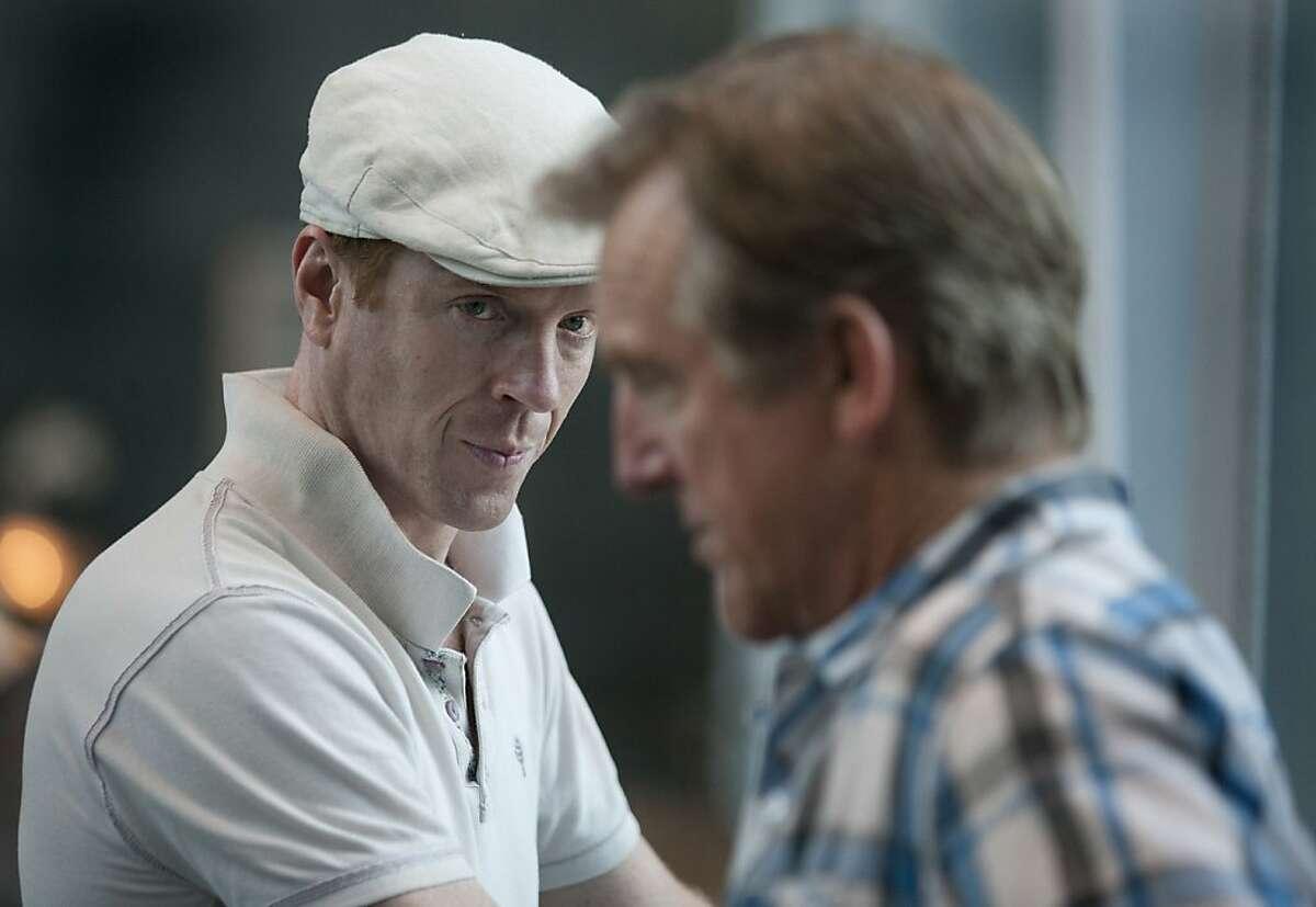 "In Season 2 of ""Homeland,"" Rep. Nicholas Brody (Damian Lewis, far) confers with Vice President William Walden (Jamey Sheridan)."