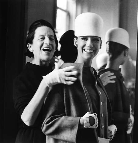 Fashion editor Diana Vreeland, who worked at Harper's Bazaar and Vogue, assists model Marisa Berenson in this portrait. Photo: James Karales, Estate Of James Karales / Samuel