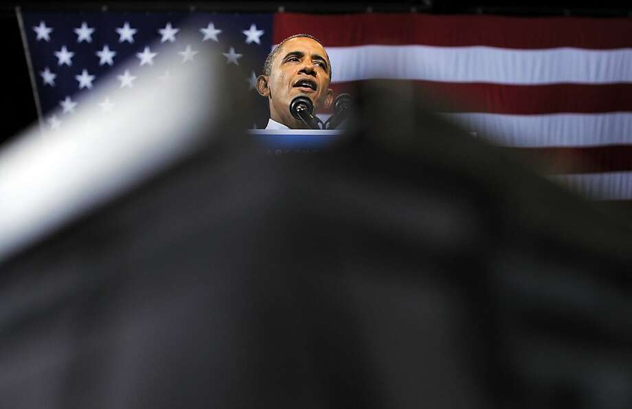 President Obama speaks at a campaign rally at Kent State University. He attributed Ohio's improving economy in part to the auto industry bailout that he backed and Romney opposed. Photo: Jewel Samad, AFP/Getty Images