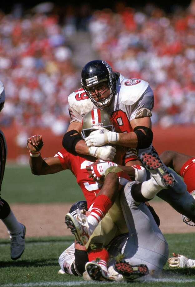 SAN FRANCISCO - SEPTEMBER 23:  Defensive end Tim Green #99 of the Atlanta Falcons tackles running back Roger Craig #33 of the San Francisco 49ers during the game at Candlestick Park on September 23, 1990 in San Francisco, California.  The 49ers won 19-13.  (Photo by George Rose/Getty Images) Photo: George Rose, Getty Images / 1990 Getty Images
