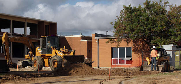 Construction continues Monday September 24, 2012 at Cameron Elementary School. Cameron Elementary School is the first of 22 San Antonio Independent School District schools to enter the construction phase for renovations. Demolition is under way in preparation for a new two-story addition. Funding for these and other SAISD improvements were approved by voters in November 2010. Photo: JOHN DAVENPORT, San Antonio Express-News / San Antonio Express-News