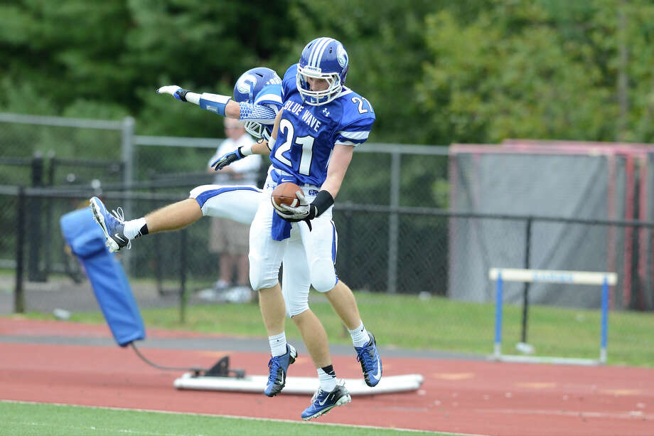 Darien's #21 Nicholas Lombardo celebrates a TD as Darien High School hosts Fairfield Warde High School in varsity football in Darien, CT on Sept. 22, 2012. Photo: Shelley Cryan / Shelley Cryan for the Stamford Advocate/ freelance Shelley Cryan